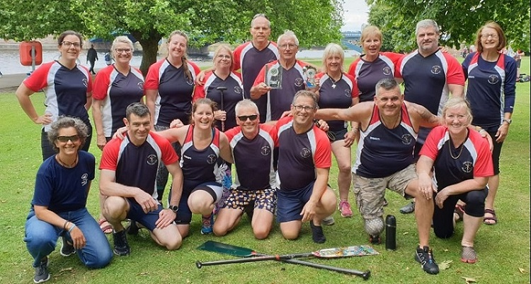 Exe-Calibre dragon boat crew at Nottingham Regatta 2019 racing on the River Trent.